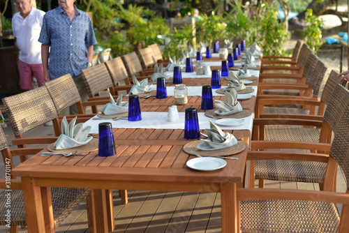Chairs And Table Arranged At Outdoor Restaurant - fototapety na wymiar