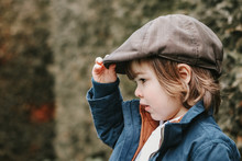 Closeup Portrait Of Cute Little Toddler Boy In Brown Cap Outdoors. Retro Or Vintage Style.  Copy Space.