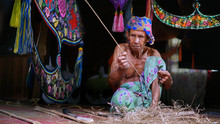 Man Working In Traditional Clo...
