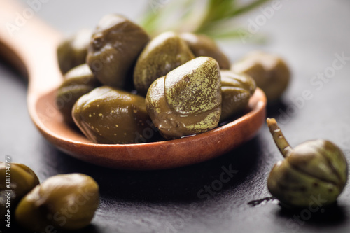 Pickled green capers close-up Canvas Print
