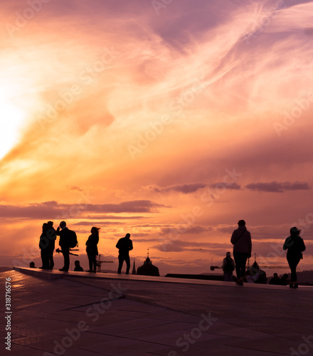 Canvas Print Silhouette People At Rooftop Against Sky During Sunset