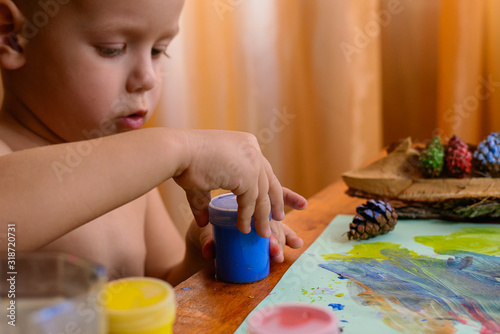 Fototapety, obrazy: Shirtless Boy Holding Paint Bottle At Home