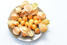 Natural Cape Gooseberry On Wooden Background