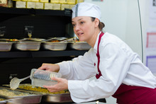 Buffet Female Worker Serving Food