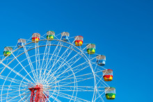 Ferris Wheel On Clear Blue Sky Background