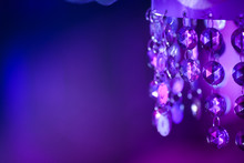 Close-Up Of Purple Decoration Hanging Against Wall