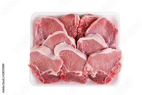 Photo A tray full of fresh Pork Loin Chops isolated on white.