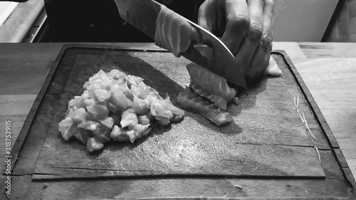 Obraz Cropped Image Of Hand Cutting Meat On Board - fototapety do salonu