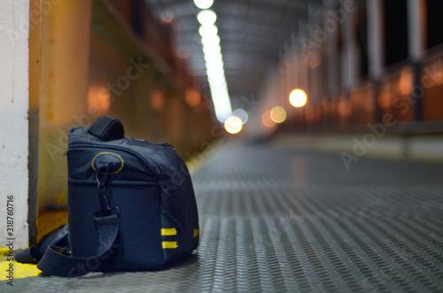 Obraz Close-Up Of Bag At Illuminated Passage - fototapety do salonu