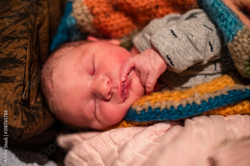 Obraz na płótnie Close up portrait of a newborn baby boy wrapped in knitted woolen blankets