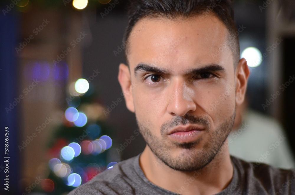Fototapeta Close-Up Portrait Of Young Man Against Illuminated Lights