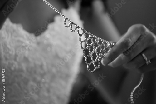 Midsection Of Bride Holding Diamond Necklace During Wedding Fotobehang