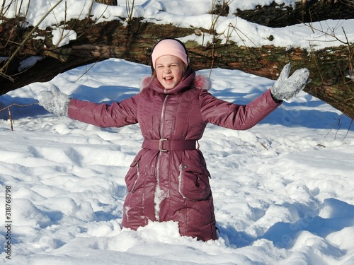 Portrait Of Girl With Arms Outstretched On Snow Canvas Print