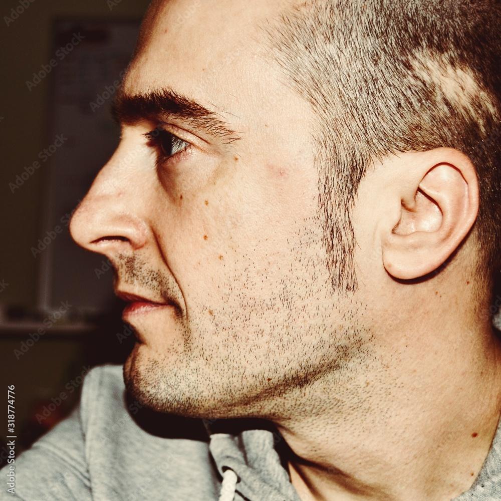 Fototapeta Close-Up Of Man Looking Away At Home