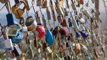 Colorful Locks On Metal Fence