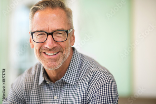 Mature handome fit man sitting outside stock photo