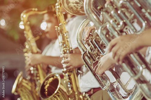 Male student with friends blow the euphonium with the band for performance on stage at night Canvas Print
