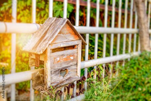 Fotografering Close-Up Of Abandoned Wooden Birdhouse On Railing