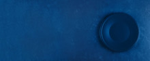 Empty Plate On Blue Concrete Background. Classic Blue. Trend Color Of 2020 Year. Top View With Copy Space. Banner For Website