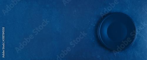 Stampa su Tela Empty plate on blue concrete background