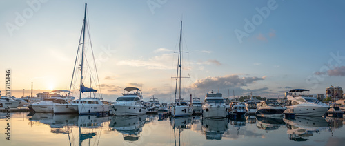 Beautiful clear sunset in the sea harbor with moored yachts.