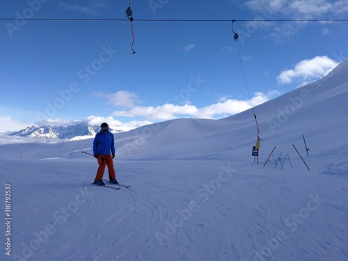 Man Skiing On Snowcapped Mountain Against Sky Canvas Print