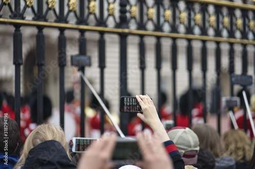 Selective focus of people gathered in front of the historic Buckingham Palace Canvas Print