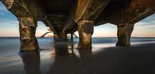 Wide Shot Of An Old Broken Bridge Over The Sea