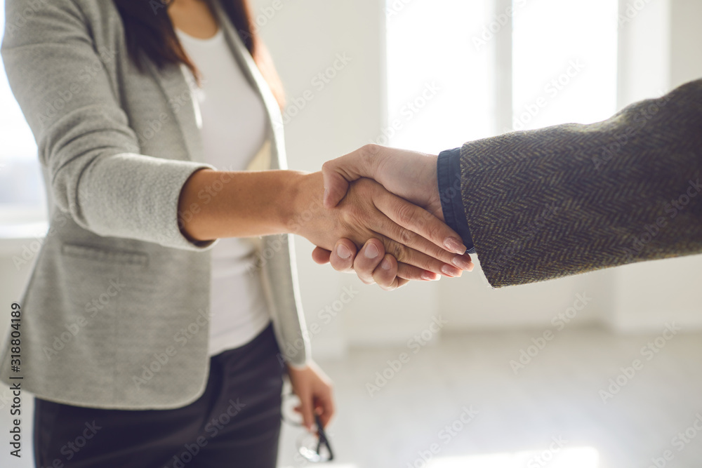 Fototapeta Handshake of businesspeople. Female and male hand makes a handshake in the office.
