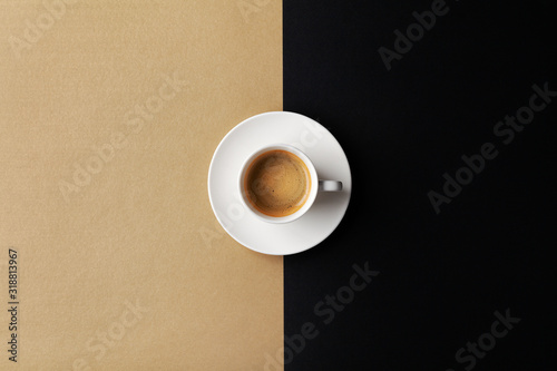Obraz Cup of coffee on gold black background. Minimalistic flat lay. Top view. - fototapety do salonu