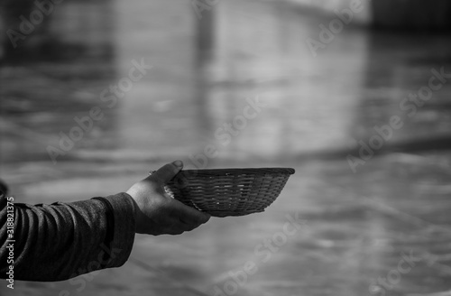 Cropped Image Of Beggar Holding Wicker Bowl Canvas Print