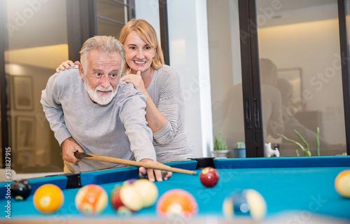 Portrait of happy caucasian senior grandparent couple playing billiard Mature old people lifestyle Tablou Canvas