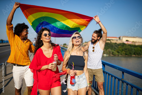 Photo Group of friends, people attend a gay pride event