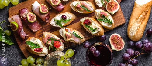 Fototapeta Mediterranean snack for wine. Traditional tapas bar, spanish table with food, platter with appetizer or italian bruschetta. obraz