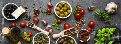 Fototapeta Mediterranean food background with herbs, olive, oil, tomatoes, basil obraz