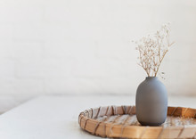 Small Vase And White Flowers On A Table Near The Window