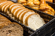 Leinwandbild Motiv Sliced bread and croissants in a basket