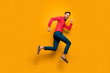 Full size profile photo of funny guy jump high up rush black friday shopping center wear trendy red shirt bow tie pants shoes outfit isolated yellow color background