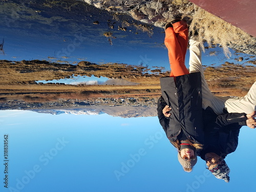 Romantic Couple Standing By Lake Against Clear Blue Sky During Sunny Day Fototapet