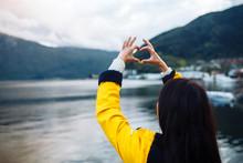 The Girl Tourist Holding Heart...