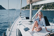 canvas print picture - Luxury travel on the yacht. Young happy woman on boat deck sailing the sea. Yachting in Greece.
