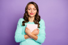 Photo Of Beautiful Curly Lady Dreamer Hold Favorite Love Novel Close To Chest Imagine Herself Main Romance Character Eyes Closed Wear Fuzzy Pullover Isolated Pastel Purple Color Background