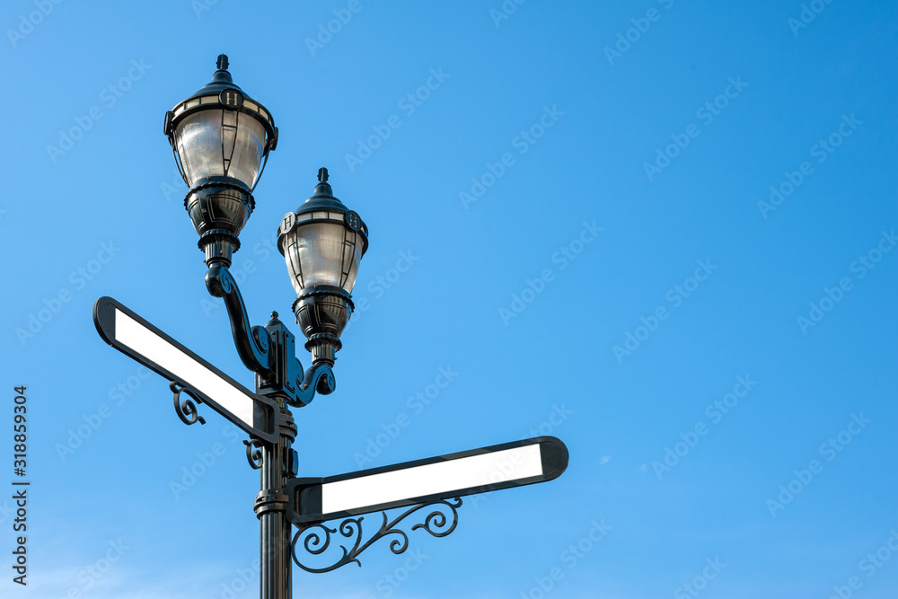 Fototapeta Antique iron streetlight with blank street names on the crossroads in Hoboken, New Jersey, USA
