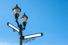Antique Iron Streetlight With Blank Street Names On The Crossroads In Hoboken, New Jersey, USA