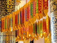 MULTI COLORED FLAGS HANGING In Buddhist Temple Wat Chiang Man, Chiang Mai, Thailand