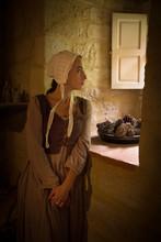 Renaissance Woman Standing At Window