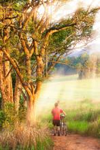 European Man Walking With Bicy...