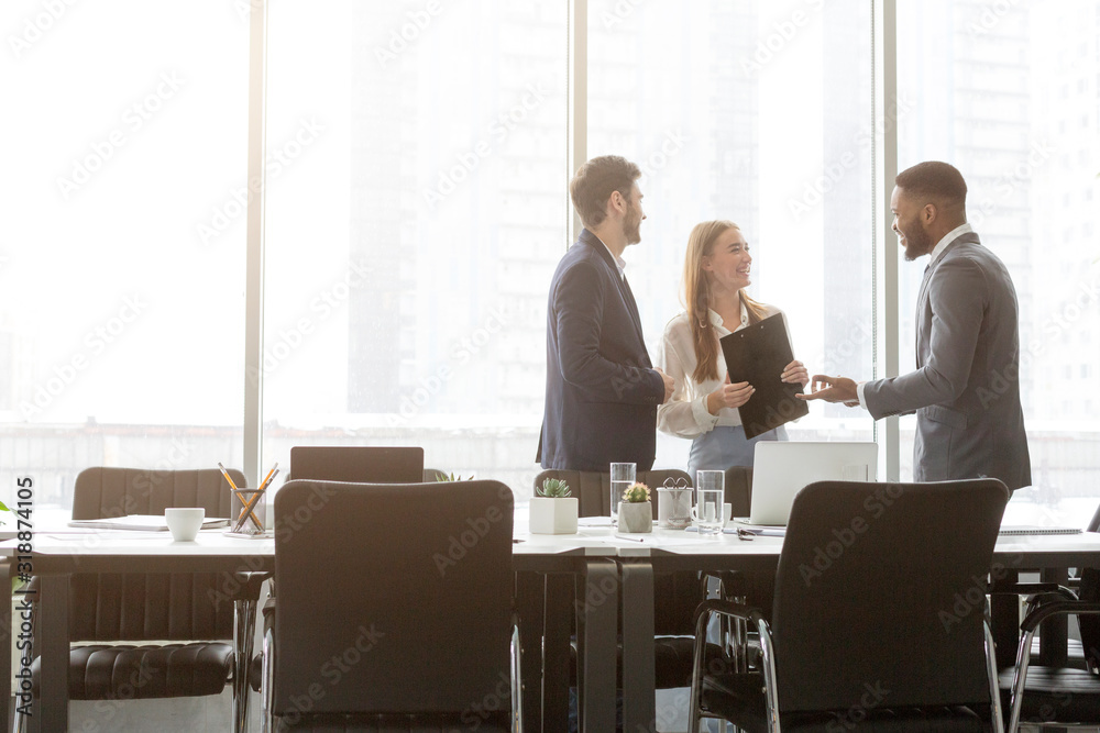 Fototapeta Business colleagues having conversation during break in office