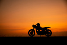 Silhouette Of Motorcycle Parki...