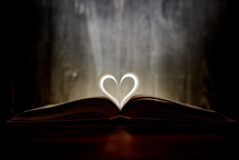 A Heart From Book Pages Shines...